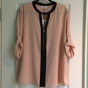 New with tags. Pink & black blouse by Calvin Klein